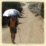 desert hiking with sun umbrella